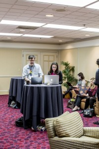Working with a conference-goer in the Social Media Lounge