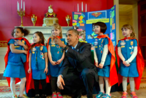 President Barack Obama faces the cameras with cape-wearing Girl Scouts from Tulsa, Oklahoma, during the 2015 White House Science Fair on Monday. Brendan Smialowski / AFP - Getty Images Source